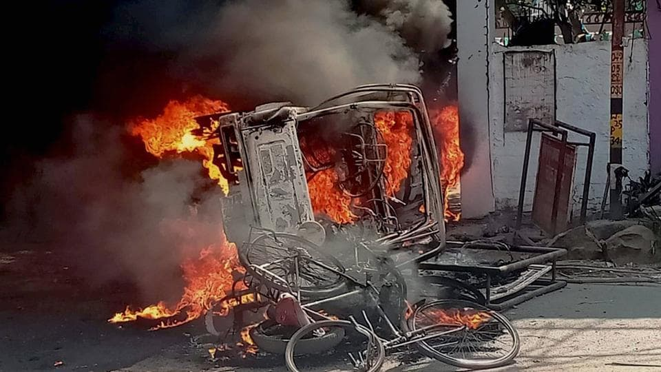 A vehicle  set afire by an angry mob during a protest over the recent police firing during a Durga Puja event in Munger, Bihar, on Thursday.