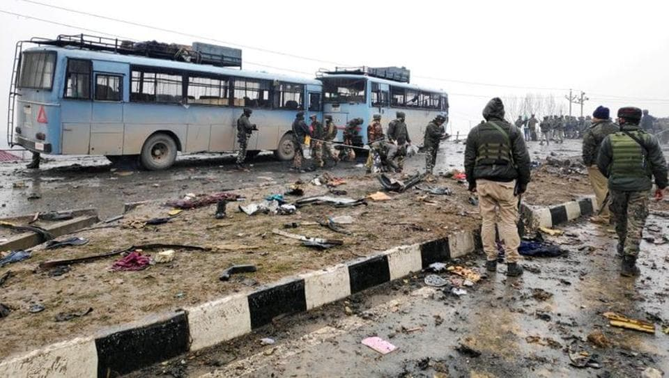 Indian soldiers examine the debris after an explosion in Lethpora in south Kashmir's Pulwama district on February 14, 2019.