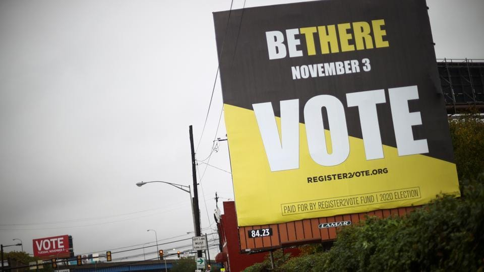 A voting sign is seen next to an avenue, in Philadelphia, Pennsylvania, US.