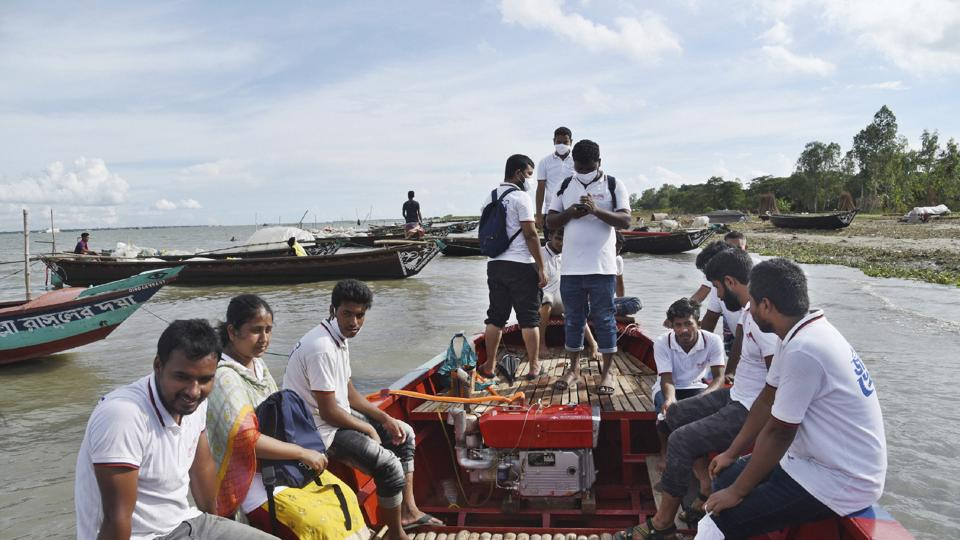 Chandpur : In this photo provided by Bidyanondo Foundation, doctors and health workers arrive at a village in Chandpur district in eastern Bangladesh, on Sept. 12, 2020. A Bangladeshi charity has set up a floating hospital turning a small tourist boat into a healthcare facility to provide services to thousands of people affected by this year's devastating floods that marooned millions.