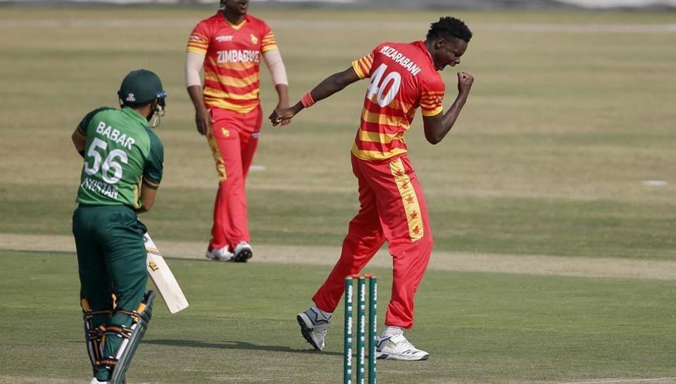 Zimbabwe's bowler Blessing Muzarabani, right, celebrates the dismissal of Pakistani batsman Babar Azam, left, during their 1st one-day international cricket match at the Pindi Cricket Stadium, in Rawalpindi, Pakistan.