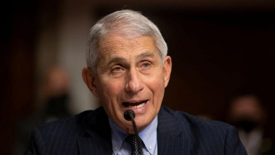 """Practically speaking, Anthony Fauci said, the first vaccine doses would likely be deployed to individuals deemed most in need """"by the end of December or the beginning of January."""""""