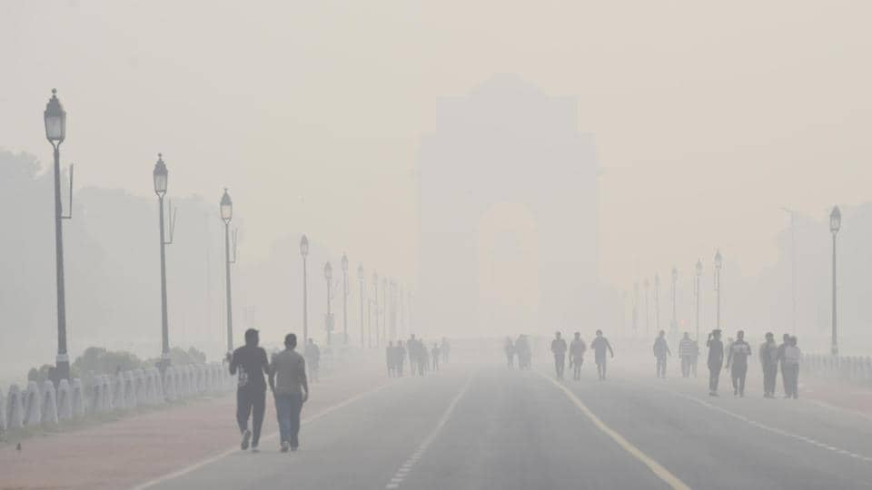Morning walkers at India Gate despite rising air pollution in New Delhi on Thursday.
