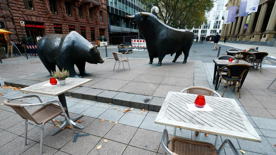 Empty tables are pictured in front of the bull and bear statues outside Frankfurt's stock exchange as the coronavirus disease (Covid-19) outbreak continues in Frankfurt, Germany on October 29, 2020.