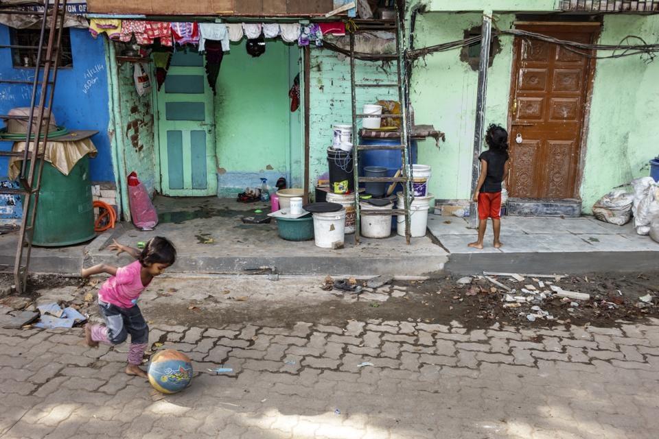Children outside their home in a slum in Mumbai.