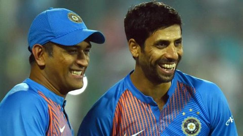 India's Ashish Nehra and Mahendra Singh Dhoni after his retirement from all forms of cricket.