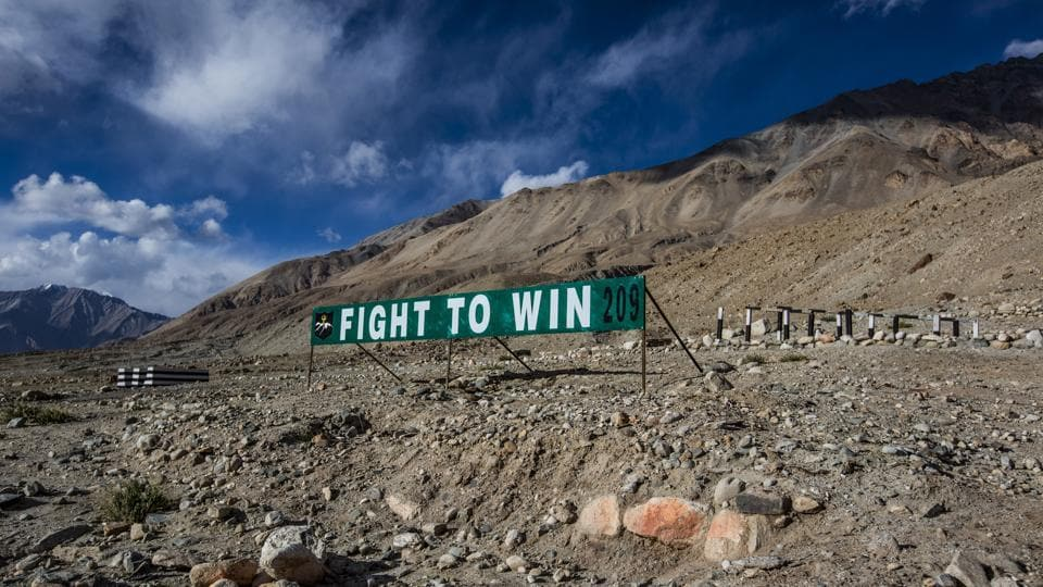 An Indian army banner post is seen on the road to Pangong Lake near to Leh, Ladakh.