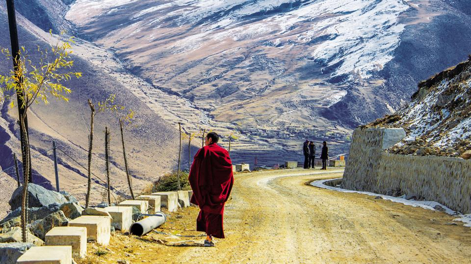 Critics say China's efforts linking poverty eradication to an embrace of a secular life and the Communist Party in Tibet infringe on human rights.