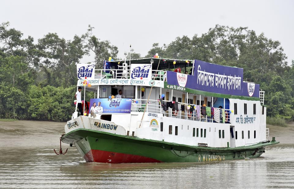 In this photo provided by Bidyanondo Foundation, floating hospital called 'Jibon Kheya',meaning lifeboat, arrives at Banishanta near Mongla seaport in southwestern region of Bangladesh, Sept. 1, 2020.. A Bangladeshi charity has set up a floating hospital turning a small tourist boat into a healthcare facility to provide services to thousands of people affected by this year's devastating floods that marooned millions. ( (AP)