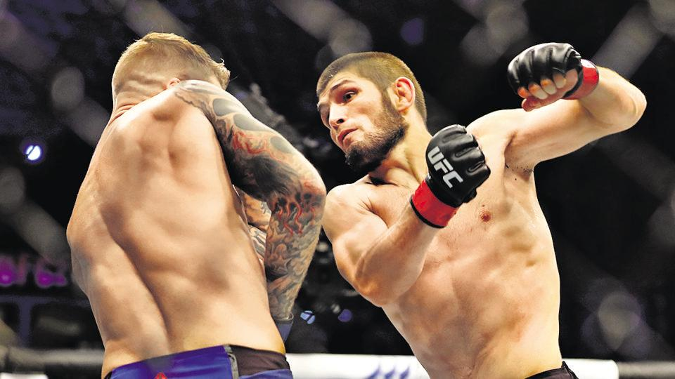 Khabib Nurmagomedov of Russia in an MMA bout with Dustin Poirier of the US, earlier this month. Nurmagomedov — a legend who has single-handedly boosted the profile of the sport — recently announced that he's retiring, following the death of his father and coach earlier this year.