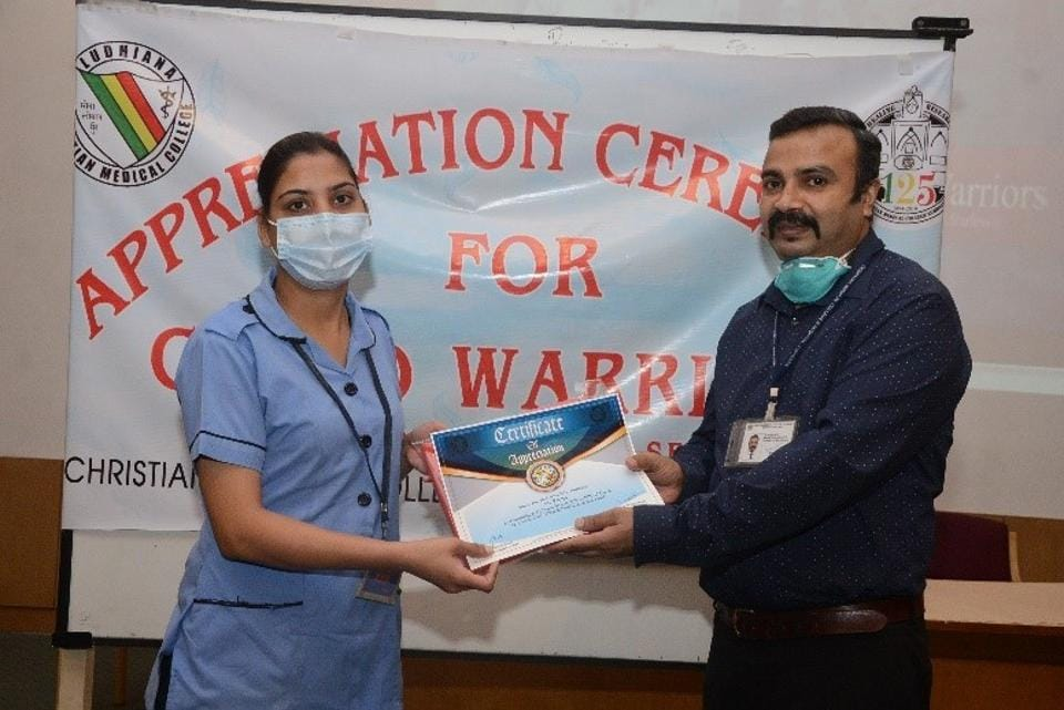 Dr Anil Luther, medical superintendent of CMCH, presenting a certificate of appreciation to an employee of the nursing department on Saturday.