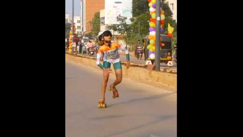 The image shows Ojal Sunil Nalavadi roller skating blindfolded.