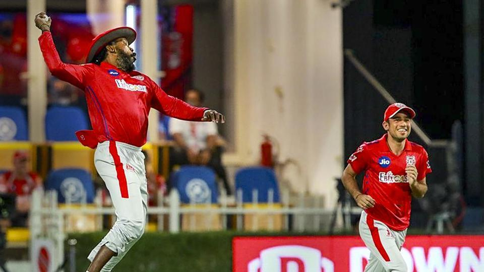 Chris Gayle of Kings XI Punjab celebrates after taking a catch for the dismissal of Nitesh Rana of Kolkata Knight Riders during their Indian Premier League (IPL) cricket match in Sharjah.