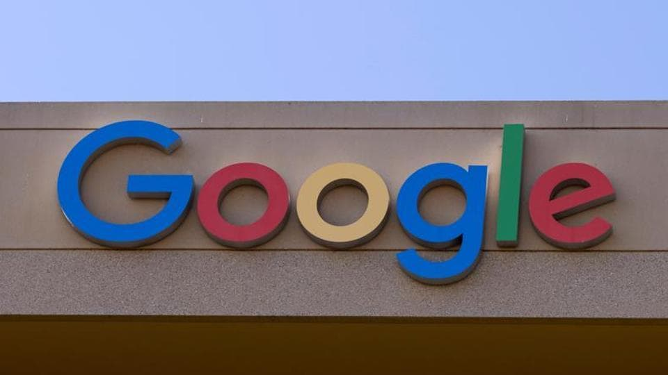 The Google sign is shown on one of the company's office buildings in Irvine, California.