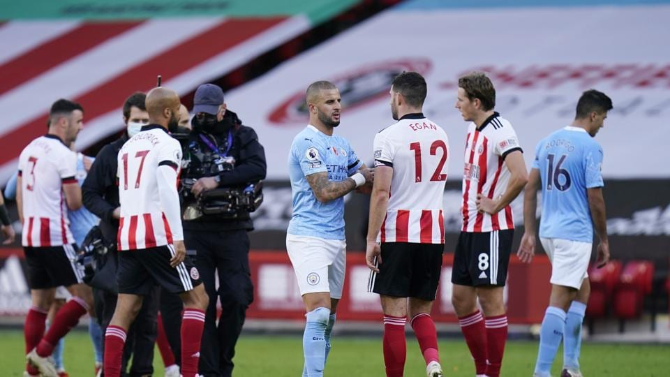 Manchester City's Kyle Walker with Sheffield United's John Egan after the match Pool via REUTERS/Tim Keeton EDITORIAL USE ONLY. No use with unauthorized audio, video, data, fixture lists, club/league logos or 'live' services. Online in-match use limited to 75 images, no video emulation. No use in betting, games or single club /league/player publications. Please contact your account representative for further details.