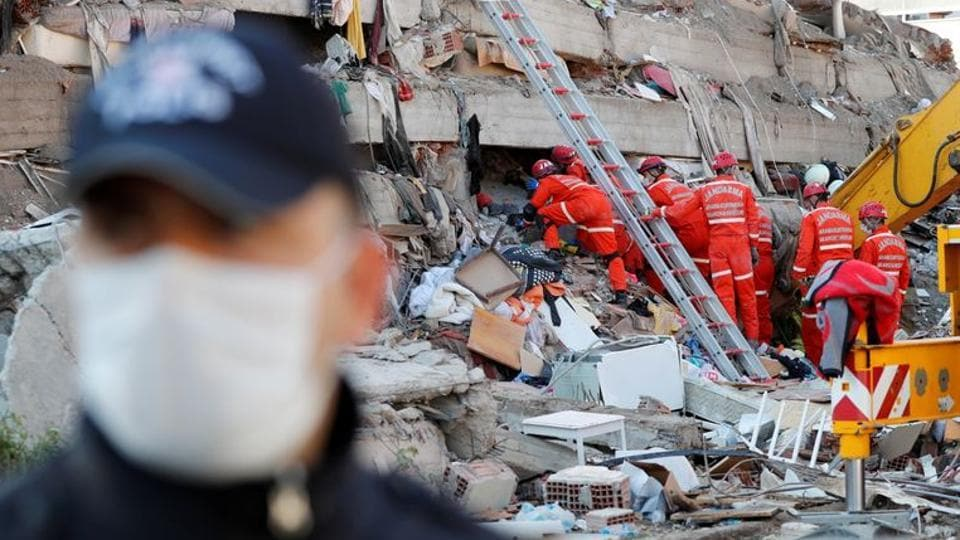 At least 20 buildings in the city were destroyed, authorities said, and the rescue work was punctuated by frequent aftershocks.