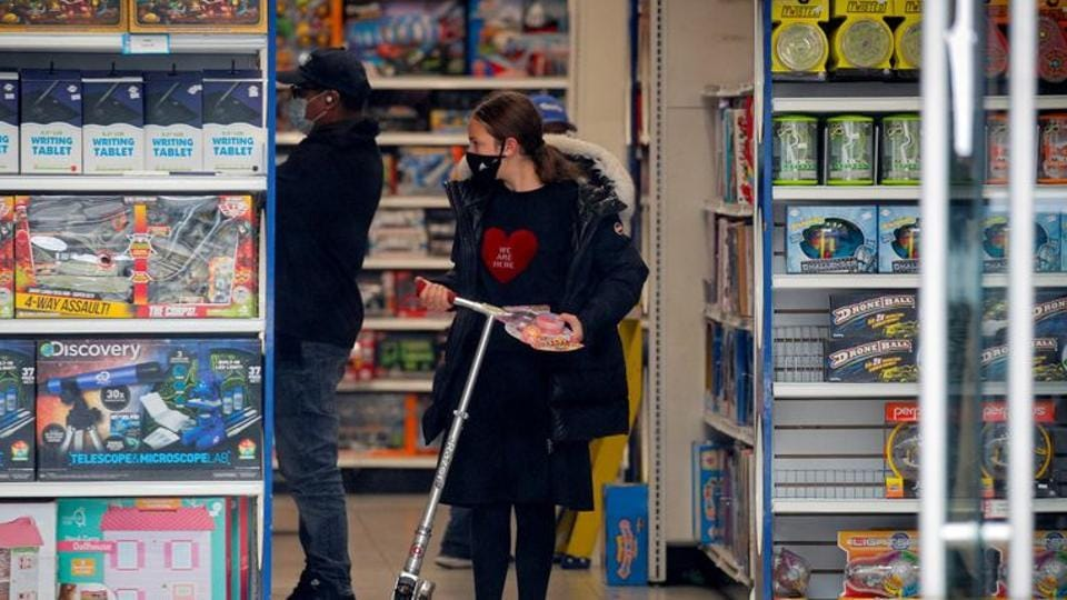 A young girl shops in a toy store during the outbreak of coronavirus disease (Covid-19) in the Borough Park section of Brooklyn, New York, US.