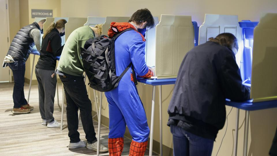 Colin Buckley of Omaha wears a Spiderman suit as he votes early on Halloween, at the Douglas County Election Commision office in Omaha, Neb., on Saturday.