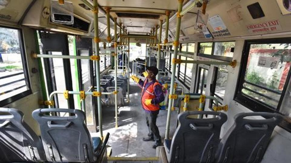 Delhi Transport Corporation (DTC) cleaning staff chemically disinfect a bus as a precautionary measure against the spread of coronavirus, at DTC Depot Rajghat in New Delhi.