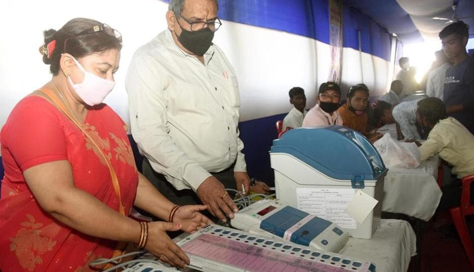 Electronic Voting Machine (EVM) sealing officers checking EVMs and Voter Verified Paper Audit Train (VVPATs) ahead of the second phase of Bihar Assembly Elections, at Bankipur Girls High School, in Patna, Bihar on Friday.