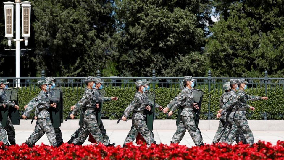 Soldiers of the People's Liberation Army (PLA) march outside the Great Hall of the People in Beijing, China September 8.