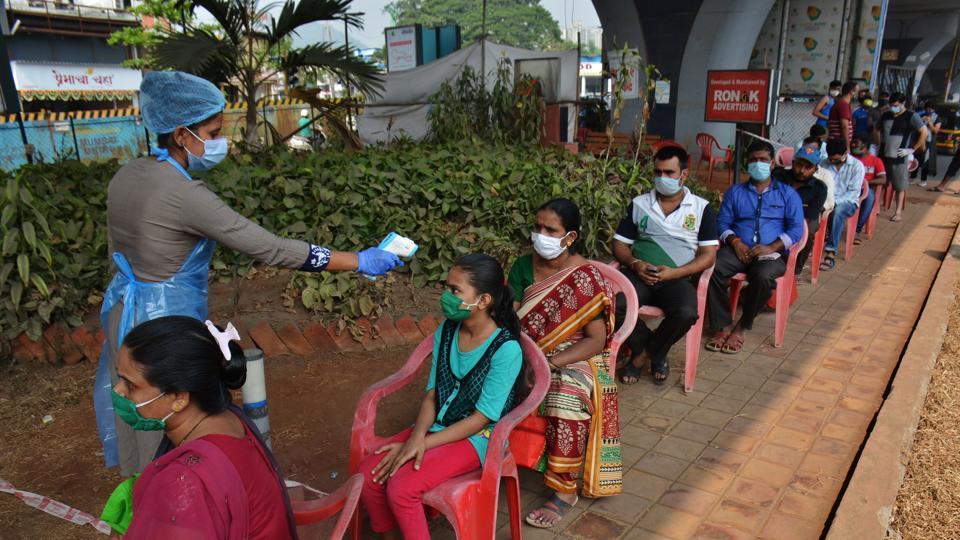 Health care workers check temperature and collect swab sample at Covid-19 testing center at Manpada GB Road at Thane, Mumbai, India, on Tuesday, November 03, 2020.