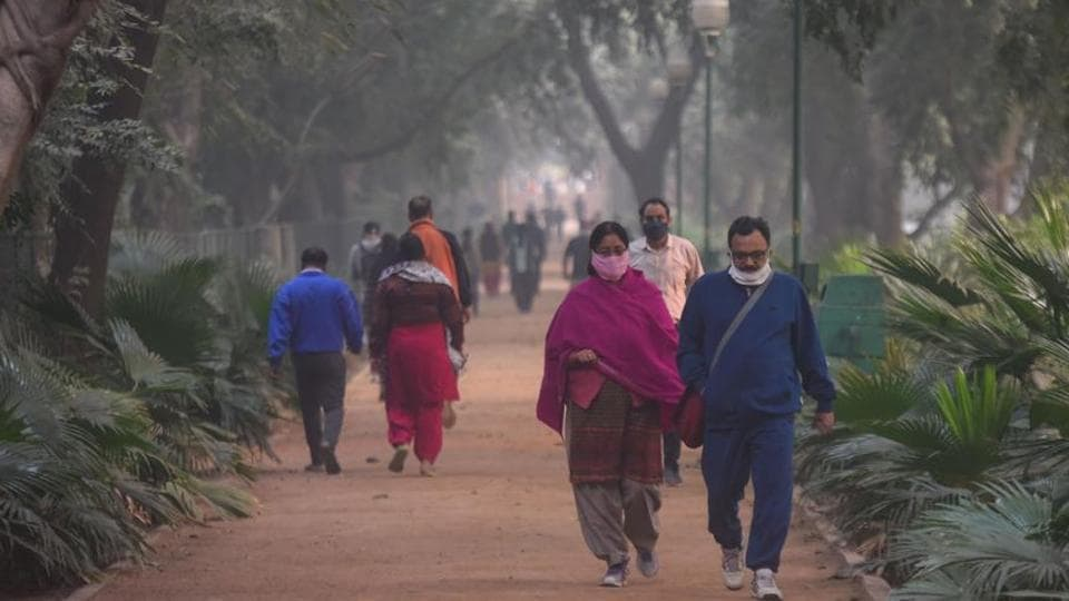 Morning walkers out in warm clothes on a cold winter morning at Green Park, New Delhi, India, on Friday, November 6, 2020.