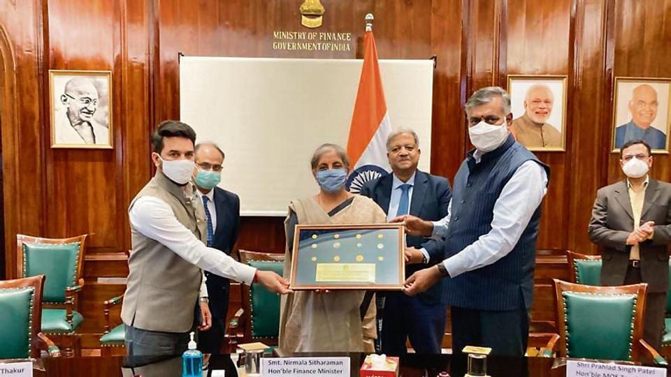 Finance Minister Nirmala Sitharaman (center) presents antiques and coins to Prahlad Singh Patel (right), MoS for Culture, in a ceremony.  MoS Finance Ministry Anurag Singh Thakur (left), Finance Secretary Ajay Bhushan Pandey (second left) and CBIC President M Ajit Kumar (second right) are also present.