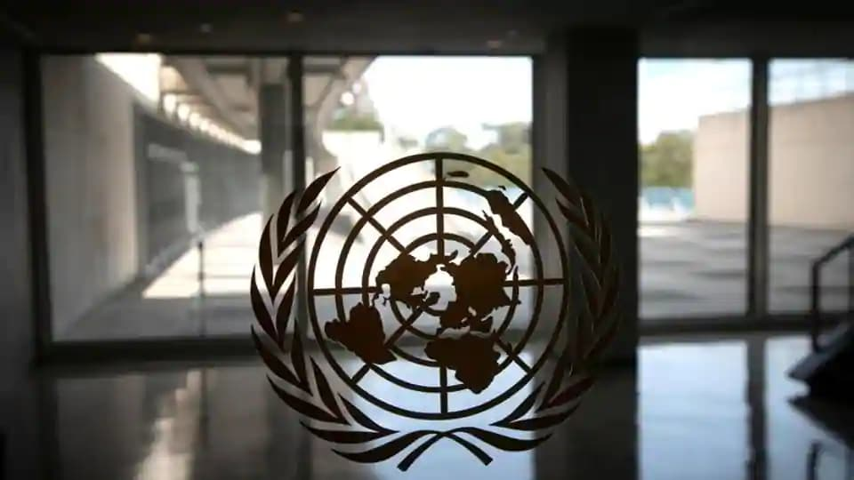 The United Nations logo is seen on a window in an empty hallway at United Nations headquarters during the 75th annual UN general assembly high-level debate.