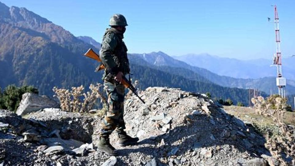 An Indian Army soldier stands guard near Nastachun pass, also known as Sadhana pass, about 8 Km from the Line of Control, Kupwara, October 14, 2020