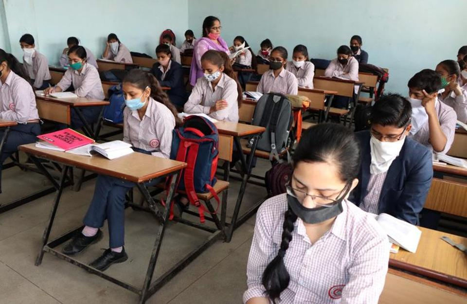 Students attending a class at Government Senior Secondary School for Girls at Bohar village in Rohtak district last week.