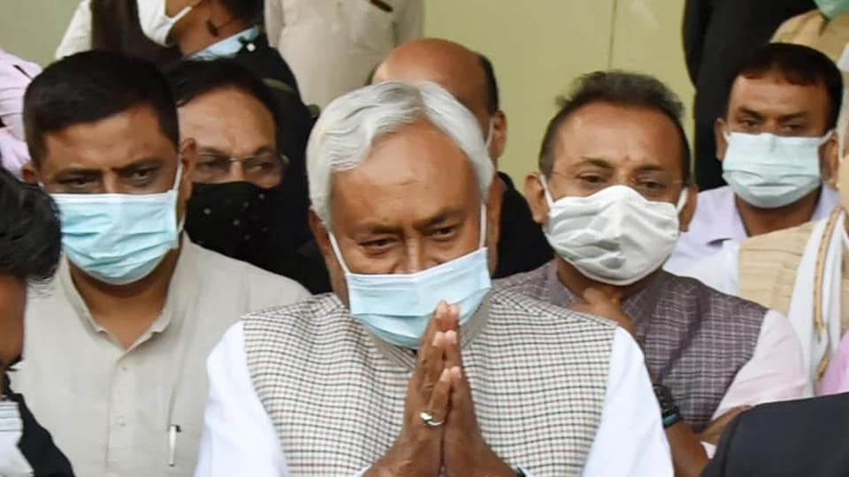 Bihar CM Nitish Kumar gestures at his supporters upon his arrival at the party office in Patna, Bihar, India, on Tuesday, Nov 17, 2020. (Photo by Santosh Kumar/ Hindustan Times)