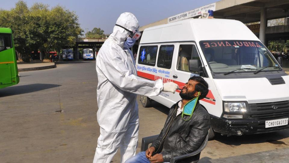 A passengers giving his sample for Covid testing at the Sector-17 ISBT in Chandigarh on Thursday.