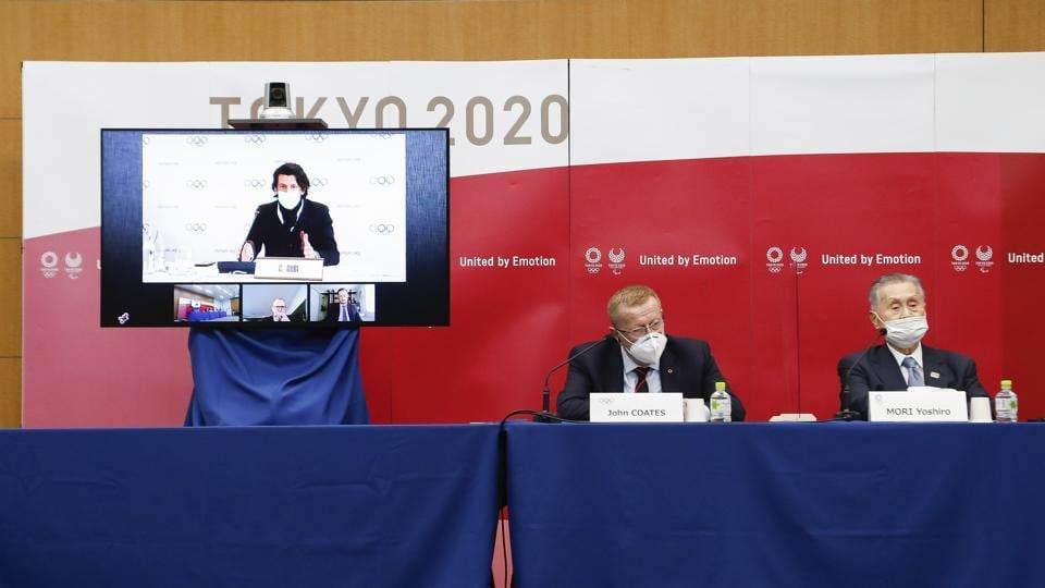 Left to right; Christophe Dubi Executive Director of Olympic Games (on the screen), John Coates Chairman of the Coordination Commission for the Games of the XXXII Olympiad Tokyo 2020 and Yoshiro Mori President of Tokyo 2020, speak during a joint press conference in Tokyo, Wednesday, Nov. 18, 2020
