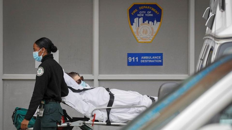 A patient arrives outside Maimonides Medical Center, as the spread of the coronavirus disease (Covid-19) continues, in Brooklyn, New York, US, on November 17, 2020.
