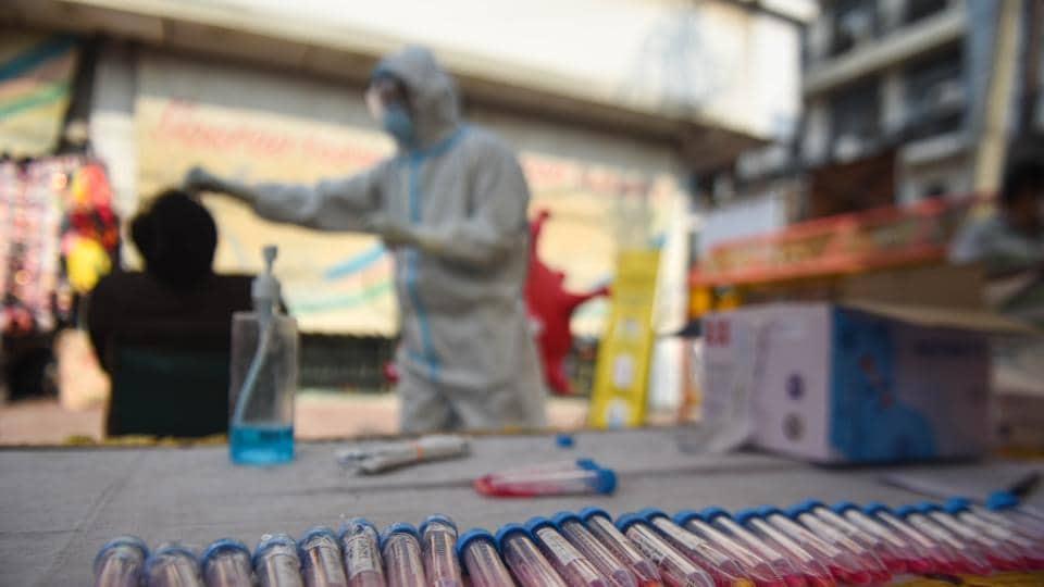 Samples taken for coronavirus testing are laid out on a table during screening, Lajpat Nagar, New Delhi, India, November 18, 2020