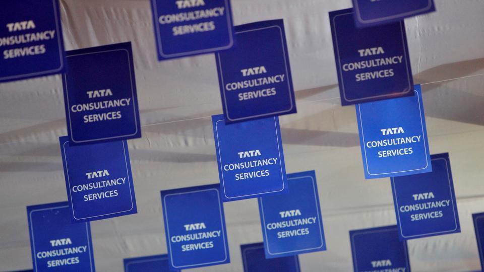 Logos of Tata Consultancy Services (TCS) are displayed at the venue of the annual general meeting of the software service provider in Mumbai in this file photo.