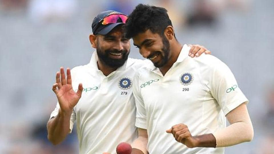 Mohammed Shami and Jasprit Bumrah of India chat during day four of the Third Test match in the series between Australia and India at Melbourne Cricket Ground on December 29, 2018 in Melbourne, Australia.