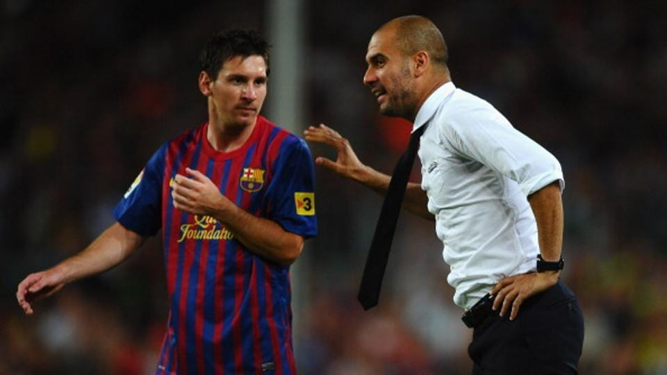 File photo of Guardiola and Messi.