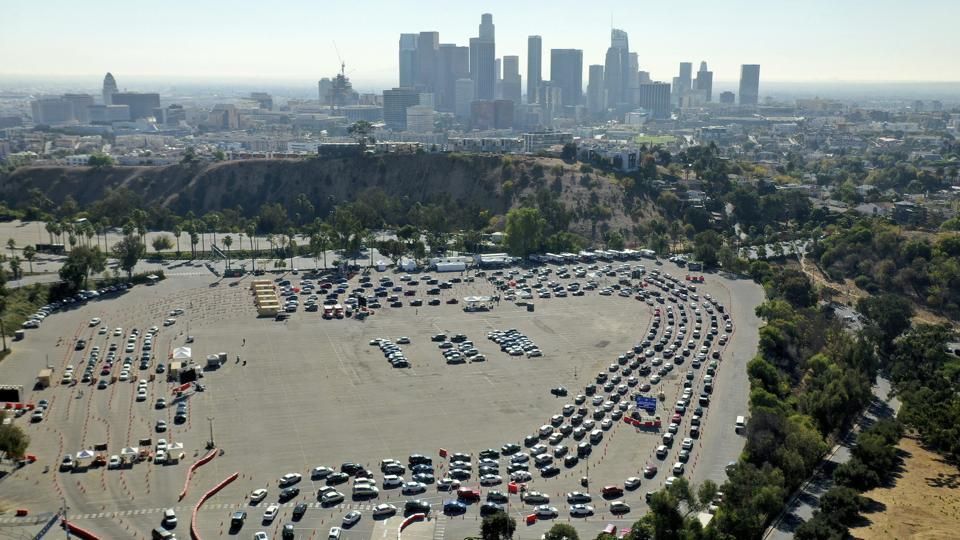 Drivers form long lines at a Covid-19 testing site in a parking lot at Dodger Stadium on November 17 in Los Angeles. The United States has surpassed 250,000 Covid-19 deaths, a bleak milestone as cases soar once again across the country, worst-hit by the deadly infectious disease. The virus is now killing at least one American every minute of the day, PTI reported citing CNN. (AP)