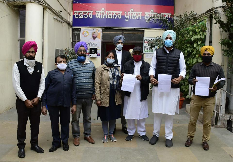 Aam Aadmi Party workers with the memorandum submitted to the commissioner of police outside his office in Ludhiana on Friday.