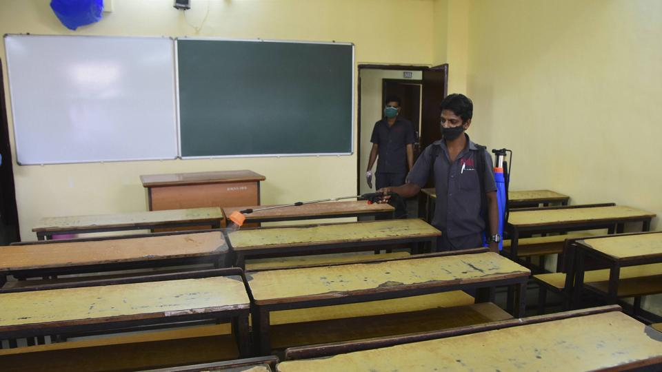 Mumbai: A worker sanitises a classroom of a school