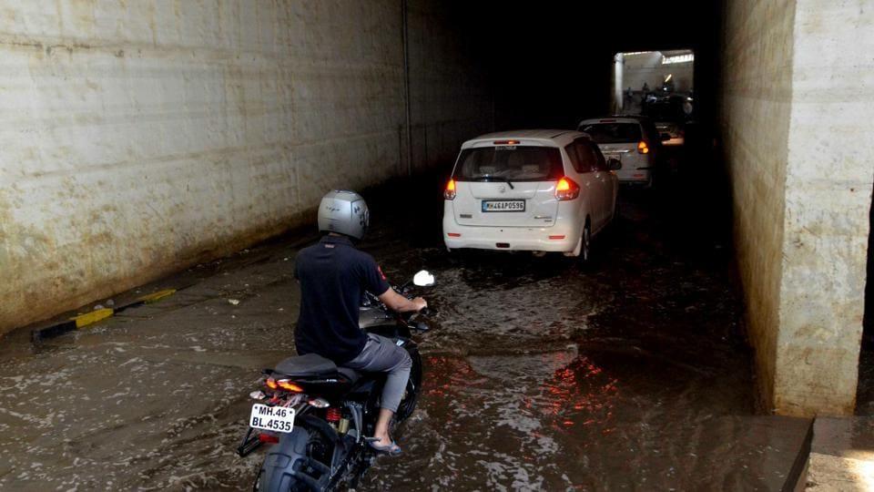Motorists drive through waterlogged Taloja subway, opened recently after repairs, in Navi Mumbai.