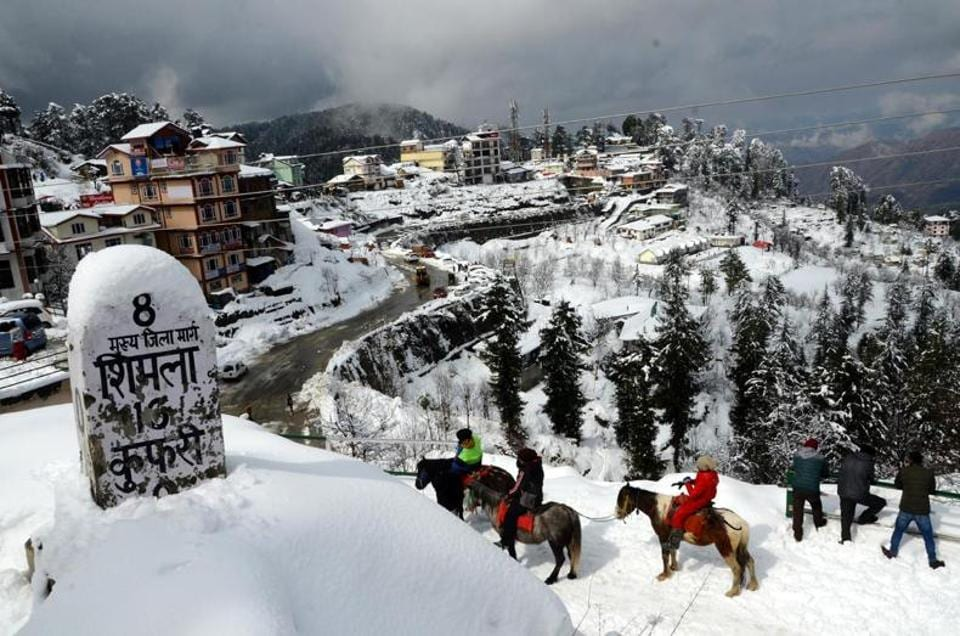Tourists enjoying a pony ride on a snow-capped trail at Kufri near Shimla after the last spell earlier this week.