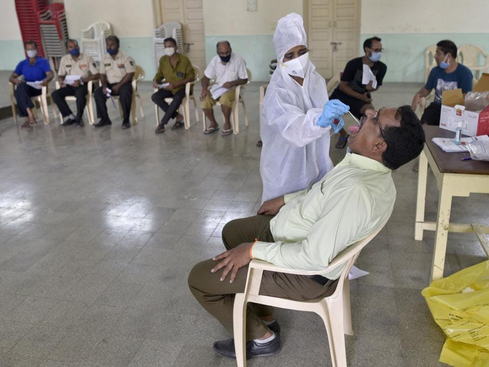 Healthcare workers during a Covid-19 screening  drive in Andheri (W) in Mumbai on November 20, 2020.