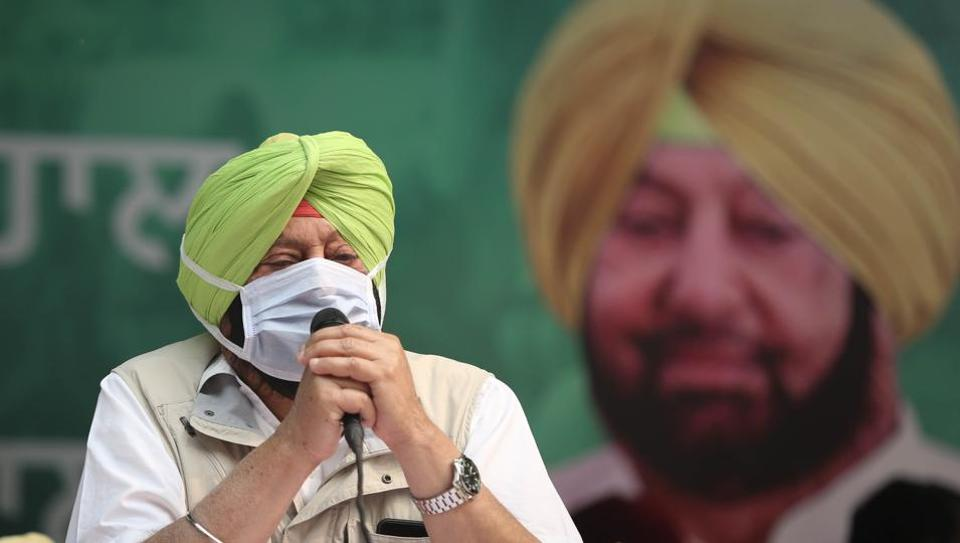 Punjab chief minister Capt. Amarinder Singh with various Congress MLAs at a sit-in protest against farm reform laws, at Jantar Mantar in New Delhi.