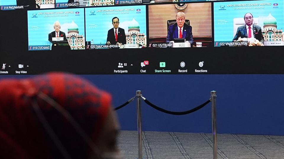 Monitor display showing US President Donald Trump, center, together with other leaders attending the first virtual Asia-Pacific Economic Cooperation (APEC) leaders' summit, hosted by Malaysia, in Kuala Lumpur, Malaysia, Friday, Nov. 20, 2020. (AP Photo/Vincent Thian)