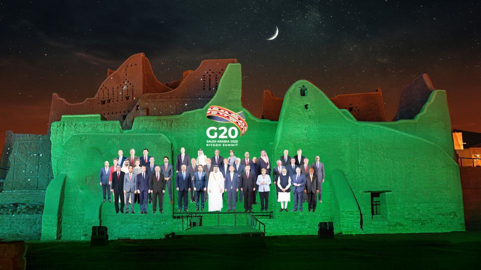 Family Photo composite for the annual G20 Leaders' Summit is projected onto Salwa Palace in At-Turaif, one of the country's UNESCO World Heritage sites, in Diriyah, Saudi Arabia, November 20, 2020.