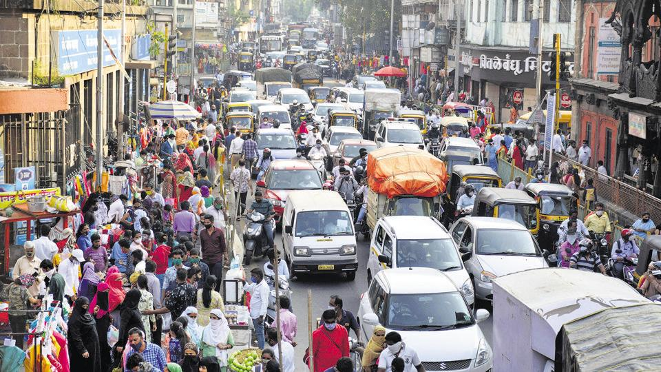 Crowd seen on Bajirao road in Pune. Despite the administration's repeated messages to residents to follow respiratory hygiene and social distancing norms in public places, Punekars were found to be roaming without masks and even spitting at crowded places during Diwali period.