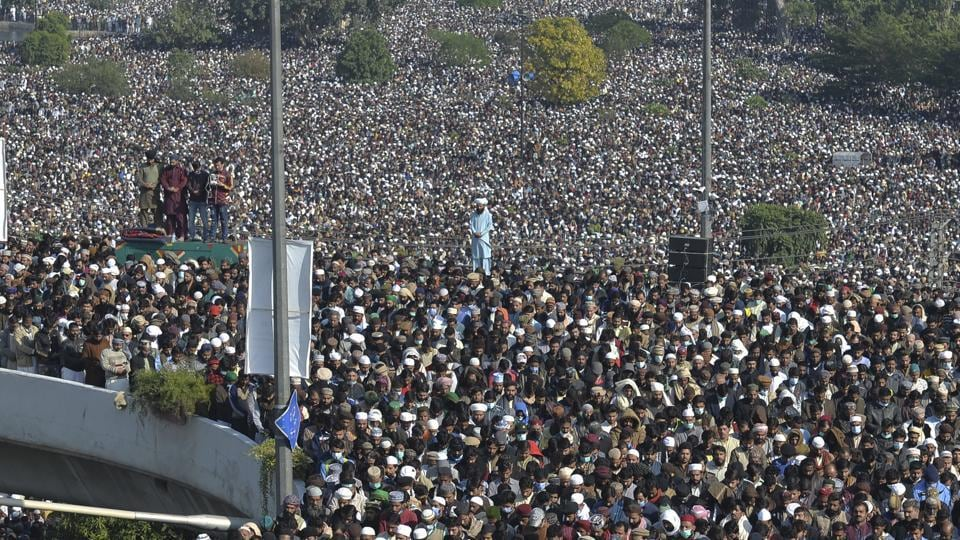 Tens of thousands of supporters on Saturday thronged the funeral of a radical cleric whose Islamist party has defended Pakistan's controversial blasphemy law that calls for the death penalty for insulting Islam